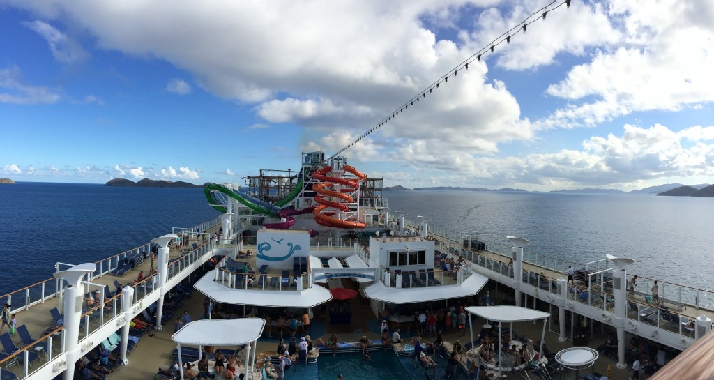 Pool and water slides on the top deck of the ship.